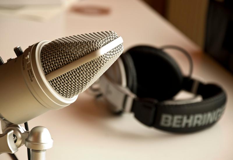 microphone and headphones in recording studio