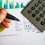 financial charts and graphs with calculator