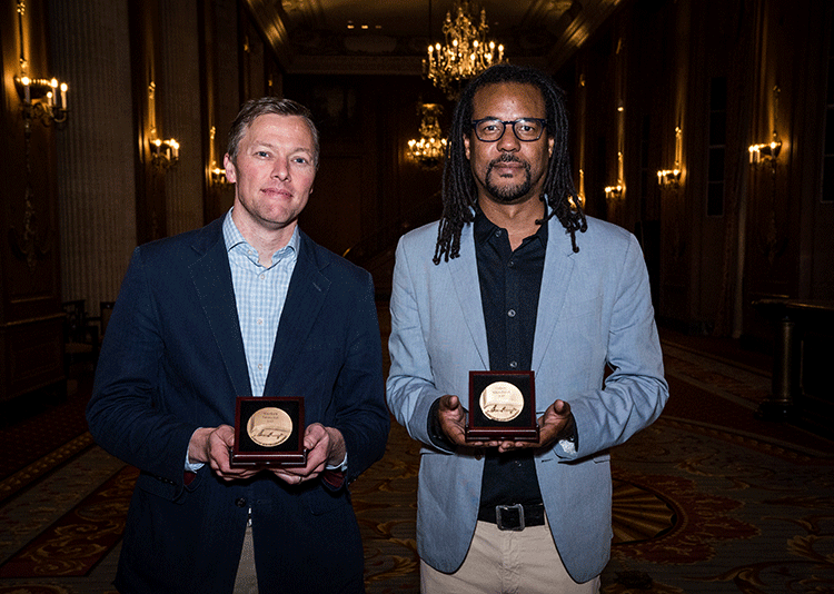 Matthew Desmond and Colson Whitehead with medals